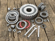 Bearings and gears on wooden background dosok. Royalty Free Stock Photo