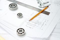 Bearings and measuring tool on drawings. Drawings, bearings and measuring tools on the desk Stock Photo