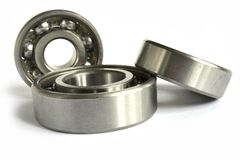 Bearings. Three close-up bearings on the white background royalty free stock image
