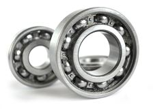 Bearings. Three close-up bearings on the white background royalty free stock photos