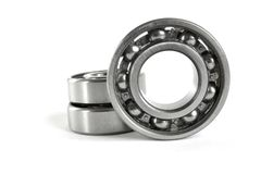 Bearings. Three close-up bearings on the white background royalty free stock photo