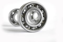 Bearings. Three close-up bearings on the white background stock photos