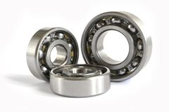 Bearings. Three close-up bearings on the white background stock photography