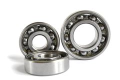 Bearings. Three close-up bearings on the white background stock photo