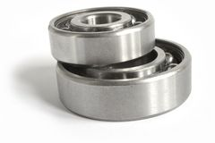 Bearings. Two close-up bearings on the white background royalty free stock photo
