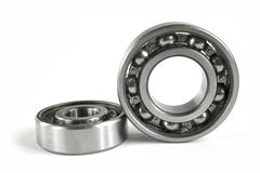 Bearings. Two close-up bearings on the white background royalty free stock images