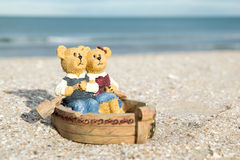 Bears in the boat figure on the beach in the evening Royalty Free Stock Photography