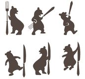 Bears with a knife and fork Royalty Free Stock Photography