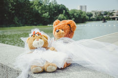 Bears. Wedding Bears sitting on the concrete near the river with views of the city Royalty Free Stock Photo