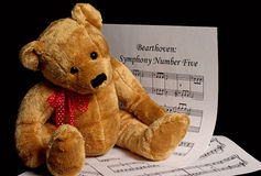 Bearthoven Symphony. A still life using a child's teddy bear and sheet music with a play on words Royalty Free Stock Images