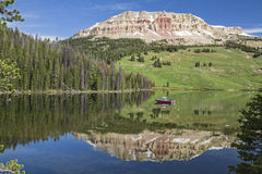 Beartooth Butte and Bear Lake with fishing boat Royalty Free Stock Photo