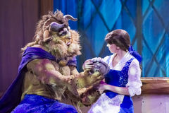 The Beast and Belle. GREEN BAY, WI - FEBRUARY 10: The Beast and Belle from Beauty and the Beast at the Disney Princesses show at the Resch Center on February 10 royalty free stock image