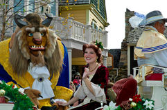Beast and Belle in Holiday Parade. Royalty Free Stock Photo