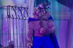 The Beast by cage. GREEN BAY, WI - FEBRUARY 10: The Beast by a cage from Beauty and the Beast at the Disney Princesses show at the Resch Center on February 10 Royalty Free Stock Image