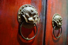 The beast Head Knocker. China traditional architectural decoration Stock Photos