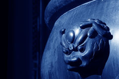 Beast head sculpture in a large metal cylinder Stock Photo