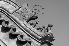 Beast sculpture in the eaves in a temple, China. Beast sculpture in the eaves in a temple under the blue sky, China Stock Photography