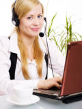Beasutiful blond woman with headphone in office Royalty Free Stock Image