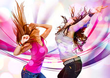 Beat 02. Two young girls dancing in discolight Royalty Free Stock Photo