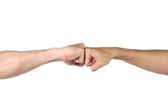 Beat. Two fists beat each other meet in a point stock image