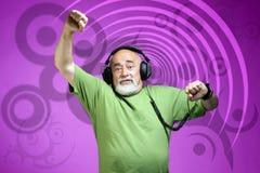 Beat. Photo of an old dancing dj with headphones Royalty Free Stock Photos