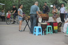 Beat the drum band in SHENZHEN. Beat the drum band members are playing music On the side of the road stock image