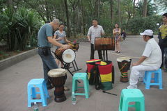 Beat the drum band in SHENZHEN. Beat the drum band members are playing music On the side of the road royalty free stock photos