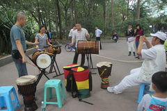 Beat the drum band in SHENZHEN. Beat the drum band members are playing music On the side of the road stock images