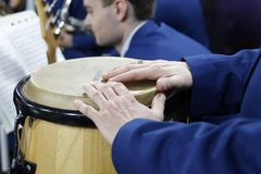 Hands on the drum stock image
