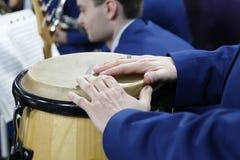 Hands on the drum. Beat the Drum.Congo drum stock image