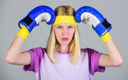 Beat headache. Girl boxing gloves tired to fight. Strong woman suffer pain. Girl painful face embrace head with boxing. Gloves. Headache remedies. Headache royalty free stock images