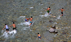 Beat the heat of Summer. The image shows the group of boys enjoying in the river during the summers in India Stock Images
