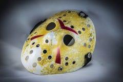 Beat up hockey mask Stock Photography