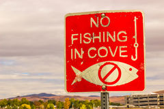 Beat Up No Fishing Sign Stock Photo