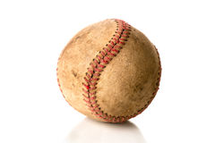A beat-up, old baseball on white. An old, grungy, beat-up baseball is on a white background royalty free stock photos