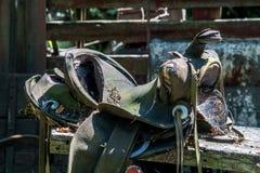 Beat up old leather saddle royalty free stock image