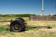 Beat up trailer in field Royalty Free Stock Images