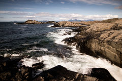 Beat of waves on a beach on Lofoten Islands Stock Images