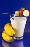 Beaten of banana with bananas and strawberry Royalty Free Stock Photography