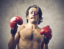 Beaten boxer. Wounded boxer with frightened and sad expression stock image