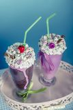 Smoothies. Are beaten with cream in the style of the sixties Stock Photography