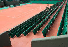 Beaten earth. Tennis court and rows of green seats Royalty Free Stock Photography