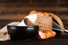Beaten egg whites. And a whisk stock photo