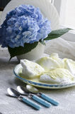 Beaten egg whites with butter cream and hydrangea Royalty Free Stock Photo