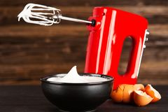 Beaten egg whites. And a mixer stock photos