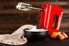 Beaten egg whites. And a mixer stock photography