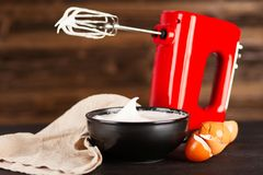 Beaten egg whites. And a mixer royalty free stock photos