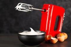 Beaten egg whites. And a mixer stock image