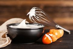 Beaten egg whites. And a whisk stock image