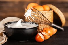 Beaten egg whites. And a whisk royalty free stock photo